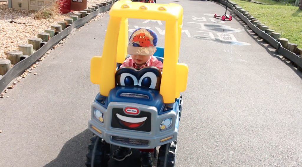 Maly driving Little Tykes Car