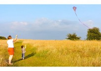 Angela and her little one flying kites