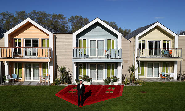 Butlin's MD, Dermot King, outside the new chalets