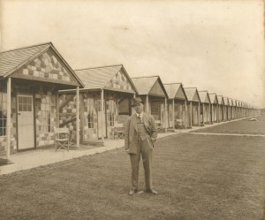 Billy Butlin outside original chalets