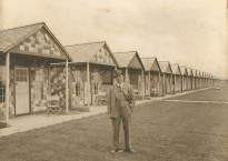 Billy in front of his original chalets