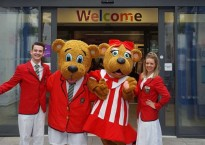 Billy & Bonnie Bear with Butlin's Redcoats outside Great Ormond Street Hospital
