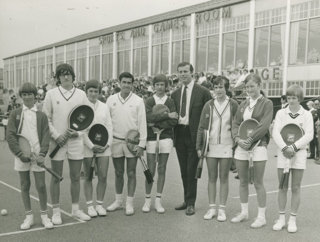 Bobbie Butlin at Tennis event with Ken Rosewall and children with BP tennis rackets. Butlins Bognor Regis.