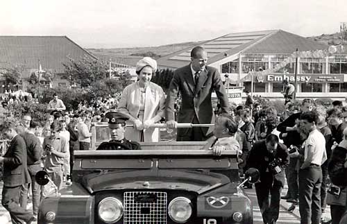 The Queen and Prince Philip touring the camp in an open-topped Land Dover