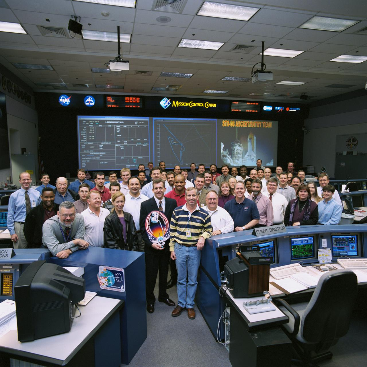 NASA Image & Video Library | STS-98 Flight Control Team Photo in the WFCR | All credits to NASA.gov